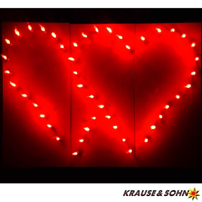 Lichterbild: Brennendes rotes Doppelherz